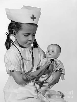 Girl Playing Nurse With Doll, C.1960s Art Print