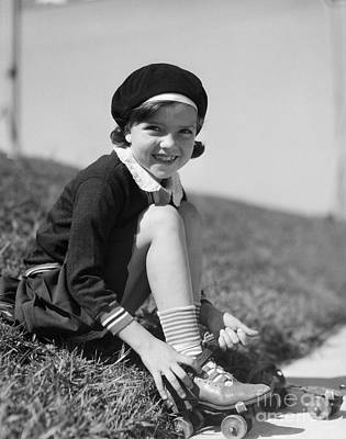 Girl Putting On Roller Skates, C.1930s Art Print by H. Armstrong Roberts/ClassicStock