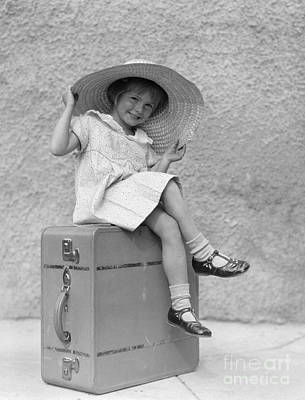 Girl Sitting On Suitcase With Big Straw Art Print