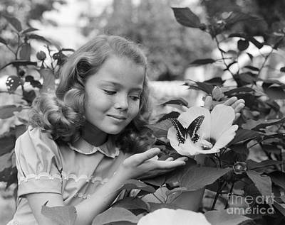 Photograph - Girl Smiling At A Butterfly, C.1950s by Debrocke/ClassicStock