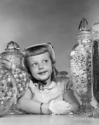 Candy Jars Photograph - Girl Surrounded By Candy Jars, C.1950s by H. Armstrong Roberts/ClassicStock
