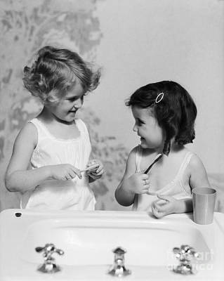 Girls At Sink With Toothbrushes, C.1930s Art Print by H. Armstrong Roberts/ClassicStock