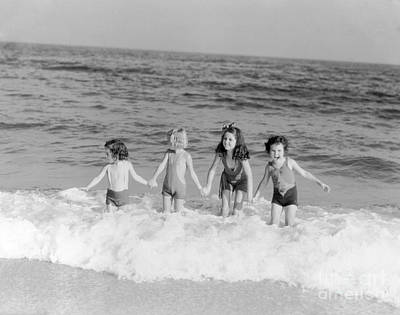 Photograph - Girls Frolicking In Surf, C.1930s by H Armstrong Roberts and ClassicStock
