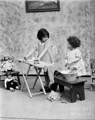 Girls Washing Doll Clothes, C.1920s Print by H. Armstrong Roberts/ClassicStock