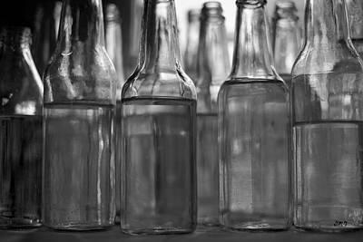 Photograph - Glass Bottles Bw I by David Gordon
