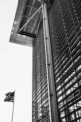 Photograph - Glass Tower With Flag by Mark David Gerson
