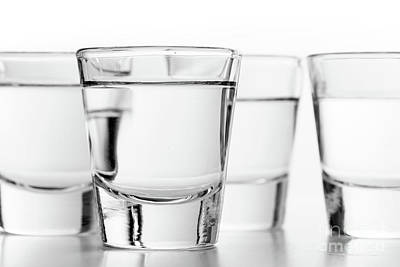Photograph - Glasses Of Vodka On White Background. Alcohol by Michal Bednarek