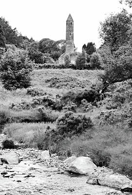 Photograph - Glendalough Ireland Round Tower Stream And Meadow County Wicklow Black And White by Shawn O'Brien