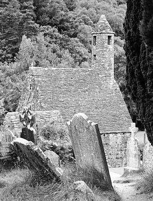 Photograph - Glendalough Ireland St Kevins Church Behind Headstones Wicklow Mountains Black And White by Shawn O'Brien