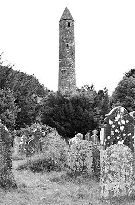 Photograph - Glendalough Irish Round Tower Above Graveyard Headstones County Wicklow Ireland Black And White by Shawn O'Brien