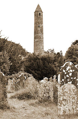 Photograph - Glendalough Irish Round Tower Above Graveyard Headstones County Wicklow Ireland Sepia by Shawn O'Brien