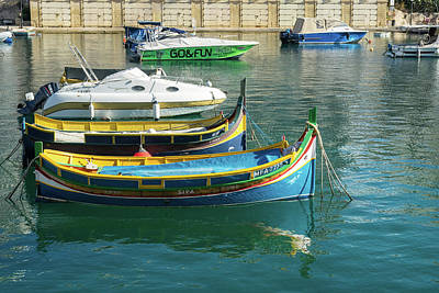 Photograph - Glossy Mediterranean Colours - Traditional Maltese Luzzus And Modern Boats Juxtaposition by Georgia Mizuleva