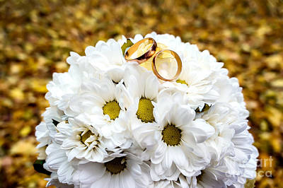 Floral Engagement Ring Photograph - Gold Rings On A Bouquet Of Daisies.  by Oleksandr Masnyi