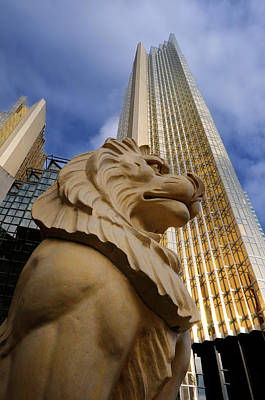 Animal Photograph - Golden Lion Statue With Gold Royal Bank Plaza Towers In Toronto  by Reimar Gaertner