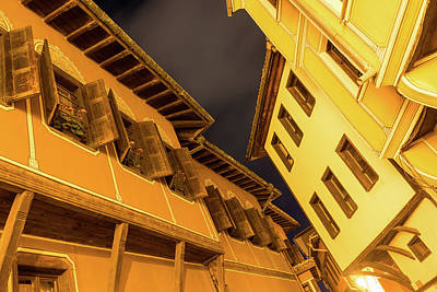 Photograph - Golden Yellow Night - Chic Zigzags Of Oriel Windows And Serrated Roof Lines by Georgia Mizuleva