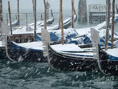 Gondolas In Venice During Snow Storm Art Print by Michael Henderson