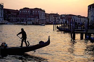 Gondolier In Venice In Silhouette Art Print by Michael Henderson