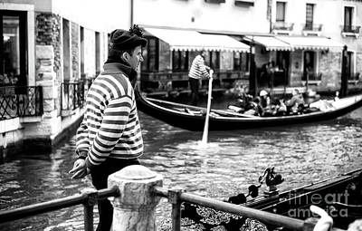 Photograph - Gondolier On The Canal by John Rizzuto