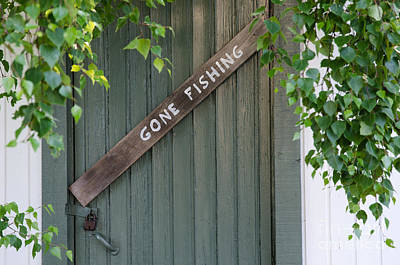 Photograph - Gone Fishing Sign At On Old Door by Kennerth and Birgitta Kullman