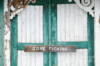 Photograph - Gone Fishing Sign At Weathered Doors by Kennerth and Birgitta Kullman