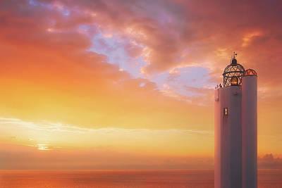 Photograph - Gorliz Lighthouse At Sunset by Mikel Martinez de Osaba