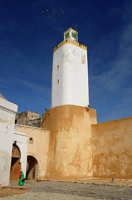 Morocco Photograph - Grand Mosque Minaret With Old Lady In Green In Old Portuguese Ci by Reimar Gaertner