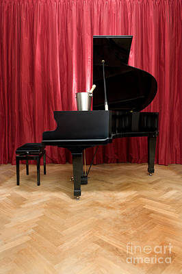 Grand Piano With A Champagne Cooler Art Print by Corepics