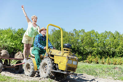 Enjoyment Photograph - Grandfather Taking Grandmother For Ride On Tractor Trailer Across Countryside by Michal Bednarek