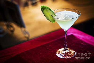 Martini Royalty-Free and Rights-Managed Images - Grapefruit And Cucumber Martini Cocktail Drink In Bar by Jacek Malipan