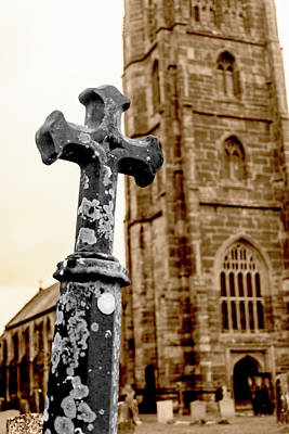 Photograph - Grave Cross With Blurred Church In Background A by Jacek Wojnarowski