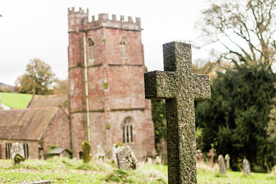 Photograph - Grave Cross With Blurred Church In Background H by Jacek Wojnarowski