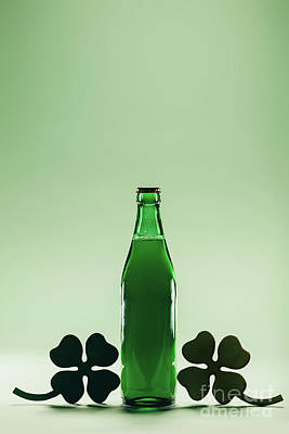Beer Royalty-Free and Rights-Managed Images - Green beer bottle. St. Patrics Day decoration by Michal Bednarek