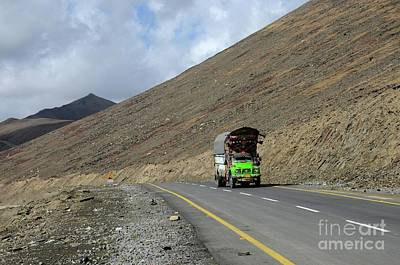Photograph - Green Goods Truck On Karakoram Highway Amid Mountains Babusar Pass Pakistan by Imran Ahmed