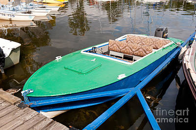 The Playroom - Green motorboat moored by Arletta Cwalina