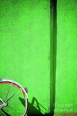 Photograph - Green Wall And Bicycle Wheel by Silvia Ganora