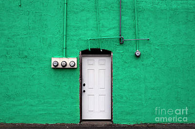Photograph - Green Wall With White Door With Utility Meters by Jim Corwin