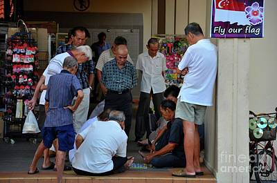 Toy Shop Photograph - Group Of Chinese Men Watch A Game Of Checkers In Singapore Neighborhood by Imran Ahmed