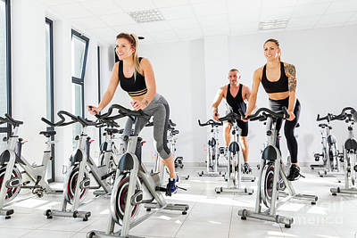 Photograph - Group Of Fit People Training At Spinning Class. by Michal Bednarek
