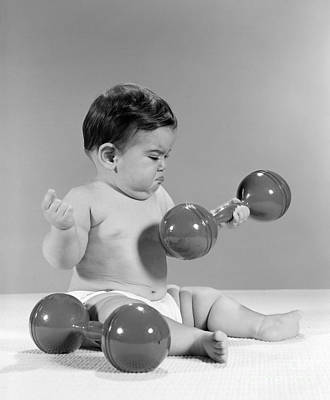 Grumpy Baby Lifting A Dumbbell, C. 1960s Art Print by H. Armstrong Roberts/ClassicStock