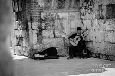 Photograph - Guitar Player In Diocletian's Palace In Split, Croatia by Global Light Photography - Nicole Leffer