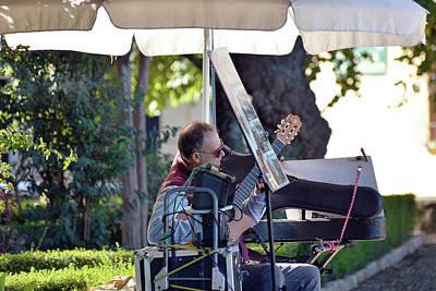 Photograph - Guitarist In The Plaza Duquesa De Parcent by Harvey Barrison