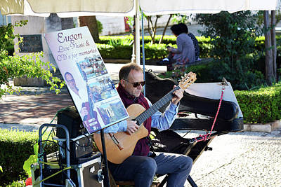 Photograph - Guitarist Performing In The Plaza Duquesa De Parcent by Harvey Barrison