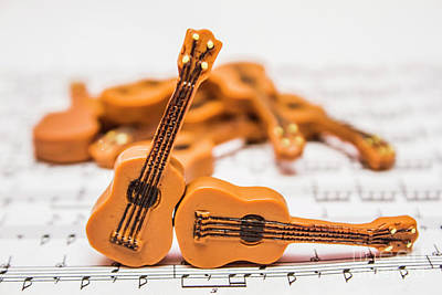 Education Photograph - Guitars On Musical Notes Sheet by Jorgo Photography - Wall Art Gallery