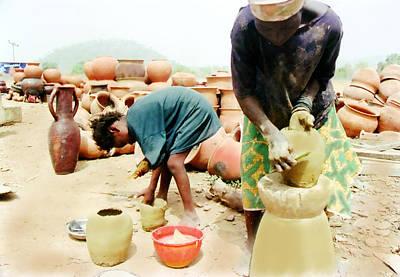 Photograph - Gwari Mum And Kid Potters by Muyiwa OSIFUYE