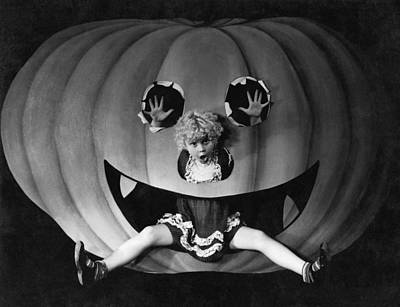 Enjoyment Photograph - Halloween Girl And Her Pumpkin by Underwood Archives