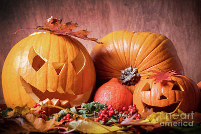 Horror Photograph - Halloween Pumpkins, Carved Jack-o-lantern In Fall Leaves by Michal Bednarek