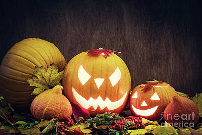 Decoration Photograph - Halloween Pumpkins Glow, Carved Jack-o-lantern In Fall Leaves by Michal Bednarek