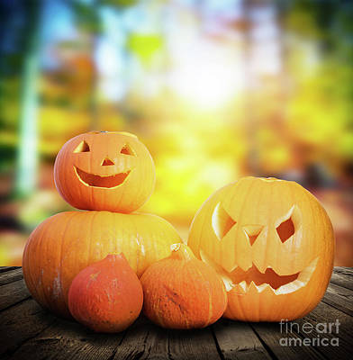 Photograph - Halloween Pumpkins On Autumn Forest Background by Michal Bednarek