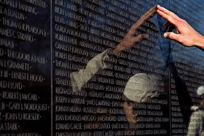 Vietnam Veterans Memorial Wall Photograph - Hand Touches And Is Reflected by Todd Gipstein