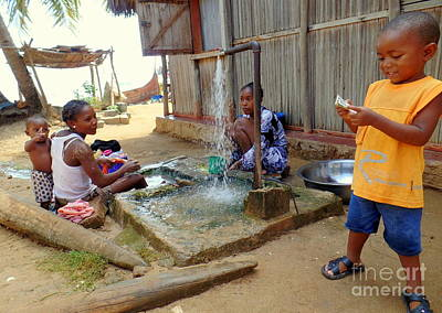 Photograph - Hand Washing Clothes by John Potts